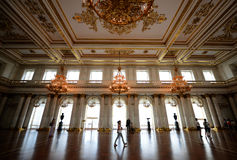 The Hermitage Museum, St. Petersburg, Russia, Royal Reception. A tourist marvels at the opulent splendor of the main royal receiving room in St. Petersburg& x27 Royalty Free Stock Images