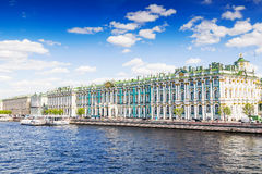Hermitage, Saint Petersburg, Russia. View Hermitage palace and Neva river under blue sky, Saint Petersburg, Russia. Famous touristic place Royalty Free Stock Photos