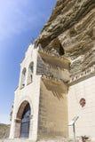 Hermitage Virgen de la Peña talló en la roca - Tosantos imagen de archivo