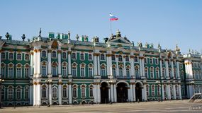 Hermitage (Winter Palace), Saint-Petersburg. Hermitage (Winter Palace), Dvortsovaya square, Saint-Petersburg, Russia, with a Russian flag tricolor Stock Image