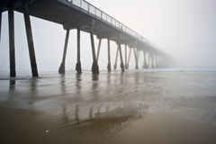 Hermosa Beach Pier Foggy. Very foggy sunset at the Hermosa Beach Pier royalty free stock images