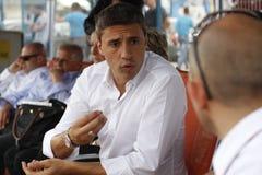 Hernan Crespo. Hernán Jorge Crespo, retired footballer, talking business with his partner in Rovinari, Romania Stock Photo