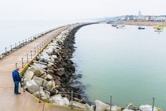 Herne Bay, Kent, the breakwater called Neptune`s arm. Royalty Free Stock Photo