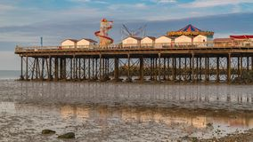 Herne Bay, Kent, England, UK. North Sea coast with the beach and the pier in Herne Bay, Kent, England, UK royalty free stock photography