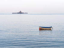 Herne Bay pier remains and boat. Stock Image