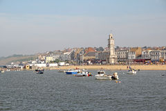 Herne bay seafront. Photo of a kentish herne bay seafront view with fishing boats in harbour with historic clock tower on foreshore Stock Photography