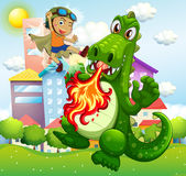 Hero fighting green dragon in park Stock Image