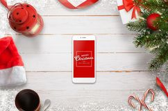 Hero header Christmas scene with mobile phone in the middle wih Merry Christmas message Royalty Free Stock Image