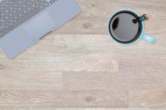 Hero Header image of tidy desktop with mug of coffee. Tidy organized desk top with laptop and cup of coffee or tea on an oak wooden table for designer workspace Stock Image
