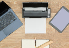Hero Header image of tidy desktop. Tidy organized desk top with laptop, tablet, scanner and notebook with pen on an oak wooden table for designer workspace Royalty Free Stock Images
