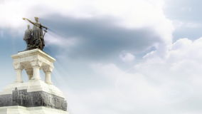 Hero monument with time lapse clouds and sun rays, stock footage. Video royalty free illustration