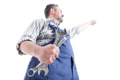 Hero shot with young mechanic pointing finger up Royalty Free Stock Image
