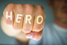 HERO written on the angry man's fist Royalty Free Stock Image