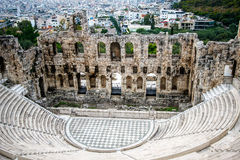 Herodes theater of the Acropolis with the city of Athens at background Stock Photos