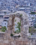 Herodion theater on Athens cityscape background. An arch of Herodion theater on Athens cityscape background Royalty Free Stock Image
