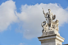 Heroes, with copy space. Three statue of heroes of the Altar of the Nation in Rome with beautiful sky Stock Photography