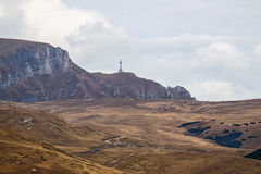 Heroes Cross on Caraiman Peak. In Bucegi Mountains from Romania. Autumn landscape with dry land Royalty Free Stock Photos