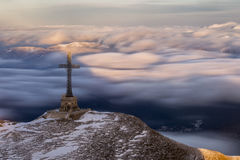 The Heroes Cross of Romania in Bucegi Mountain with clouds movin Royalty Free Stock Photos