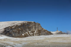 The Heroes Cross of Romania in Bucegi Mountain with clouds movin Royalty Free Stock Photo