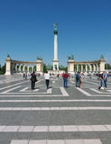Heroes' Square, Budapest, Hungary. Tourists visit the Millennium Monument in Heroes' Square, Budapest, Hungary. This square, along with Andrassy Avenue, has been royalty free stock photos