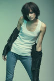 Heroin chic. Androgyny female model in Heroin chic style. Old style tinted image Stock Images