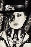 Heroine movie. Portrait of a beautiful steampunk woman over vintage background Stock Photography