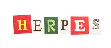 Herpes inscription from cut out letters royalty free stock photo