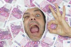 Herr Euro sagt O.K. blinzeln an Ihnen Stockbilder