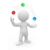 Herr Smart Guy som jonglerar med kulöra bollar Arkivfoto