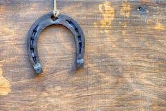 Herradura en el tablero de madera del vintage Imagen de archivo libre de regalías