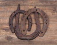 Herradura oxidada vieja de la buena suerte del vintage Fotos de archivo libres de regalías