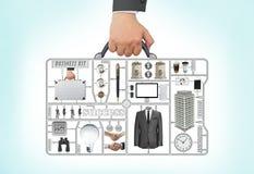 Herramienta del equipo del negocio de la cartera de la tenencia de la mano y de brazo del hombre de negocios Fotografía de archivo libre de regalías