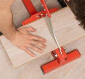 Herramienta roja para cortar la lamina fotografía de archivo libre de regalías