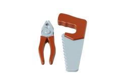 Herramientas de la carpintería del juguete. Alicates y una sierra. imagenes de archivo