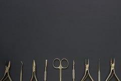 Herramientas de la manicura en el fondo oscuro Foto de archivo libre de regalías