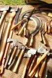 Herramientas de la mano en un paño textured Imagen de archivo libre de regalías