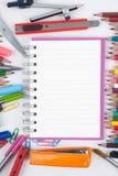 Herramientas del cuaderno y de la escuela o de la oficina en el fondo blanco Fotografía de archivo libre de regalías