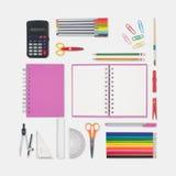 Herramientas del cuaderno y de la escuela o de la oficina en el fondo blanco Foto de archivo libre de regalías