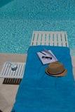 Herramientas del escritor en la piscina Fotografía de archivo libre de regalías