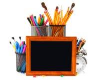 Herramientas del marco y de la escuela En el fondo blanco Imagen de archivo libre de regalías