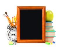 Herramientas del marco y de la escuela En el fondo blanco Fotografía de archivo libre de regalías