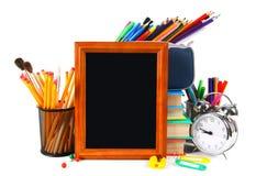 Herramientas del marco y de la escuela En el fondo blanco Fotos de archivo libres de regalías