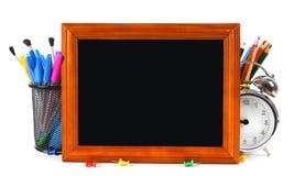 Herramientas del marco y de la escuela En el fondo blanco Imagenes de archivo
