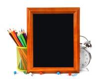 Herramientas del marco y de la escuela En el fondo blanco Imágenes de archivo libres de regalías