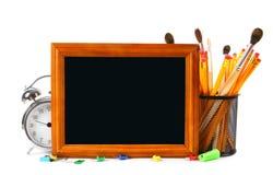 Herramientas del marco y de la escuela En el fondo blanco Foto de archivo libre de regalías