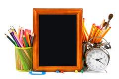 Herramientas del marco y de la escuela En el fondo blanco Imagen de archivo