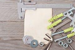 Herramientas del papel y de la trabajo de metalistería Foto de archivo