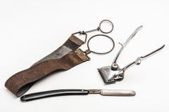 Herramientas del peluquero del vintage Foto de archivo libre de regalías
