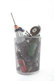 Herramientas eléctricas de la mano en un cubo de basura Imágenes de archivo libres de regalías