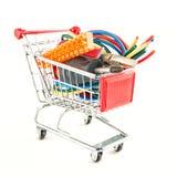 Herramientas eléctricas en un carro de la compra Imágenes de archivo libres de regalías